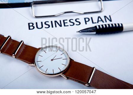 Wristwatch On A Business Plan Documents