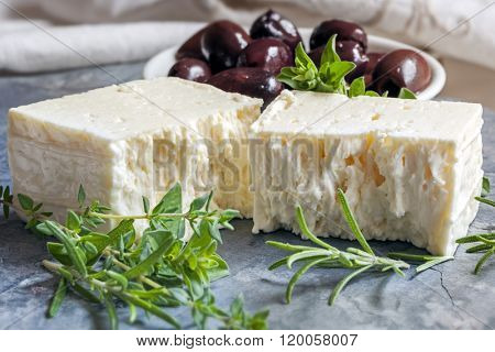 Goats cheese with black olives and herbs.