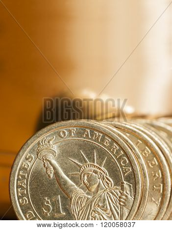 American dollar coins with gold background.
