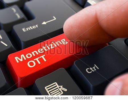 Finger Presses Red Keyboard Button Monetizing OTT.