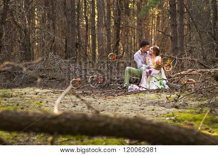 Beautiful couple in forest.