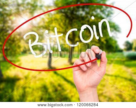 Man Hand Writing Bitcoin With Black Marker On Visual Screen.