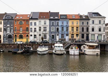 GHENT BELGIUM - 18TH FEBRUARY 2016: A view of colorful buildings along Nieuwbrugkaai and Portus Ganda in Ghent.