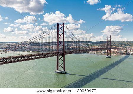 Lisbon cityscape with 25 de Abril suspension Bridge, Portugal