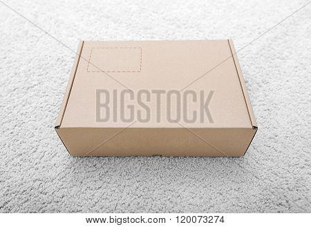 Parcel. Cardboard box in the interior.