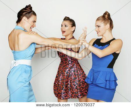 three elegant fashion woman fighting on white background