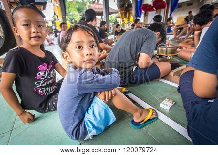 UBUD, BALI / INDONESIA - MAR 1, 2016: Unidentified children at the time of preparations for Ngrupuk parade, which takes place on the eve of Nyepi day in Bali. Nyepi is a public holiday in Indonesia.