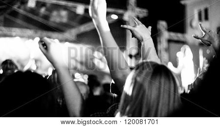 fans during a live concert visible noise due high ISO soft focus slight motion blur