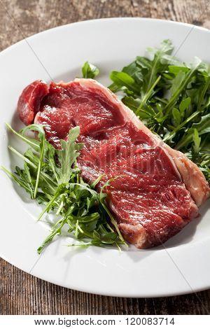 Raw Loin Steak On Rocket Salad