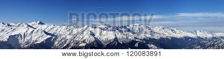 Large Panoramic View On Snowy Mountains In Sunny Day