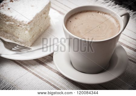 Cup With Coffee And Cake On Table
