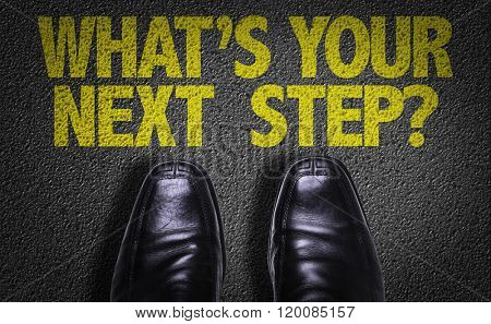 Top View of Business Shoes on the floor with the text: Whats Your Next Step?