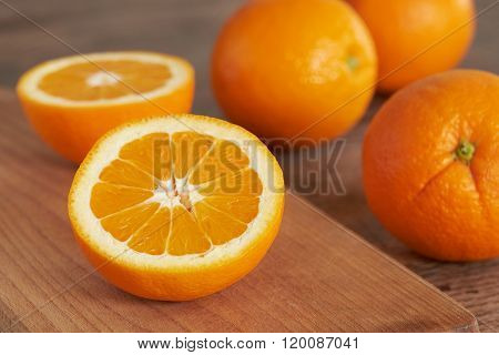 Orange. Cut Orange On A Wooden Cutting Board.