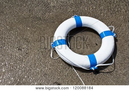 Nautical Life Saver Floating On The Water