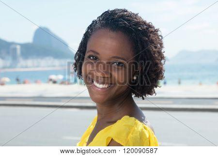 Beautiful African American Woman In A Yellow Shirt At Rio De Janeiro