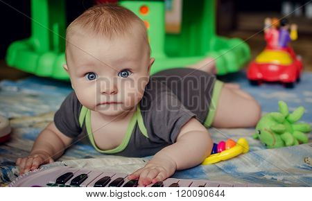 Baby Boy Playing With Piano Toy