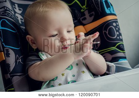 Adorable Baby Learning To Feed Himself For The First Time