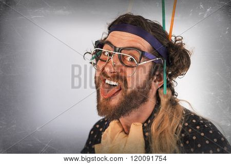Bearded crazy person lunatic wearing several pairs of glasses