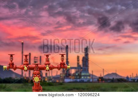 Fire Hydrants And Oil Refinery Plant Blur Background.