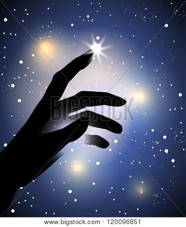 hand  touching with a finger a star