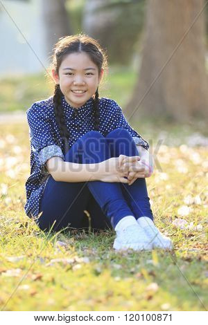 Thai 12S Years Girl Sitting On Garden Field Toothy Smiling Face Happiness Emotion
