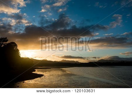 sunrise in sea bay New Zealand