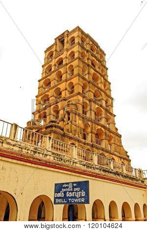 THANJAVUR/INDIA FEBRUARY 29 2016: Bell Tower at Thanjavur Palace Complex captured against cloudy sky