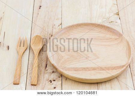 Empty Wooden Plate And Spoons, Forks.