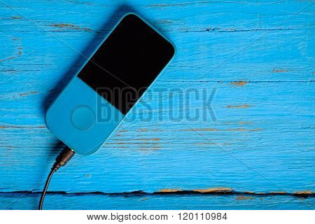 Player Headphones On A Blue Background