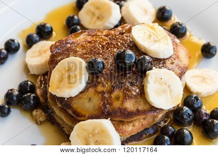 Pancakes with blueberries and bananas