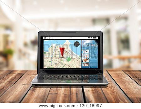 technology, navigation and advertisement concept - laptop computer with gps navigator map on screen