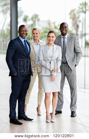group of multiracial businesspeople standing together in office