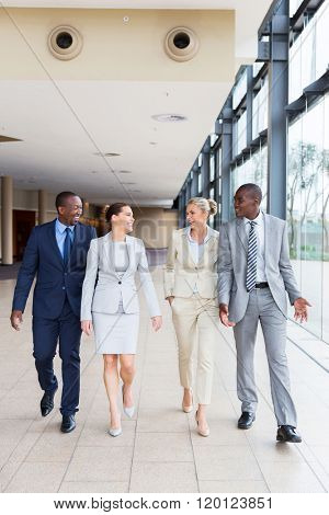 successful business team walking in office