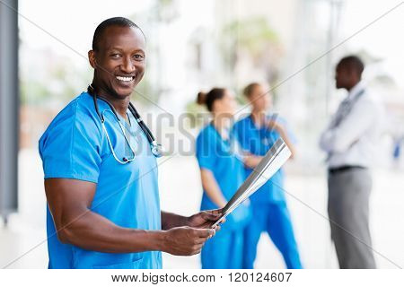 cheerful african american male doctor holding x-ray