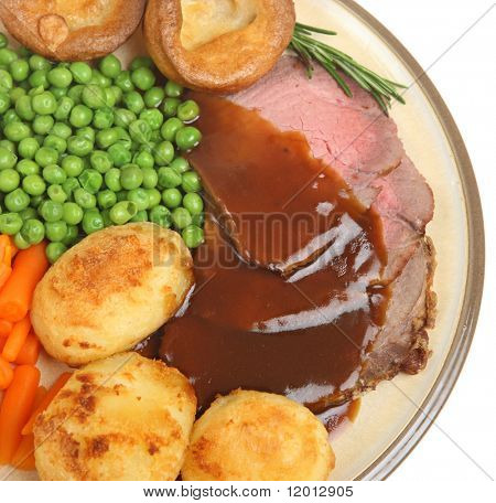 Roast beef dinner with Yorkshire pudding and gravy.