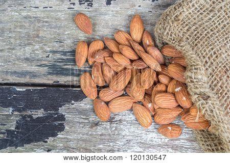 almond with hemp sacks on old wooden
