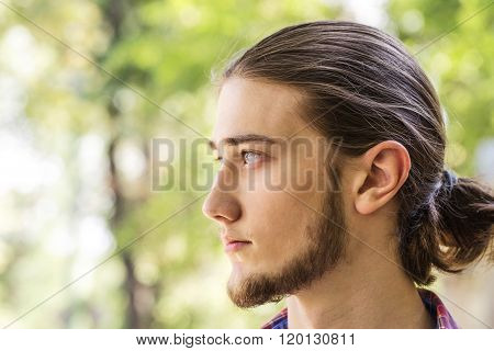 Portrait of handsome young long hair man.