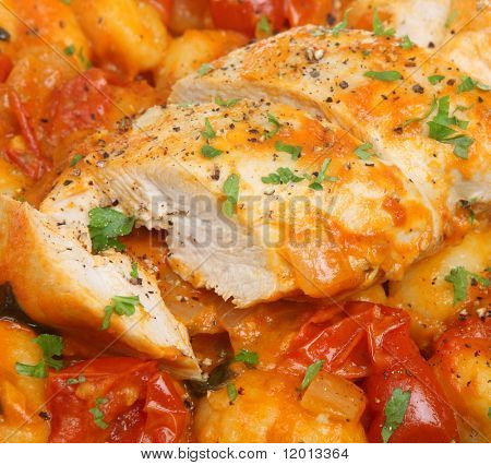 Italian casseroled chicken breast with gnocchi pasta and cherry tomatoes