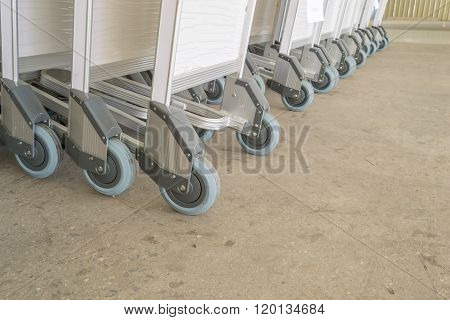 luggage carts at airport ,Close up trolleys luggage in a row in airport