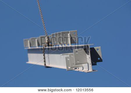 Steel girder swinging from crane