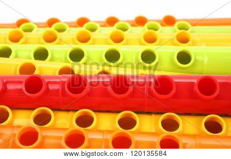 Colorful plastic flutes or fifes