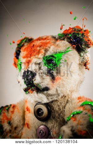 Portrait Of Magic Teddy Bear Painted By Green And Orange