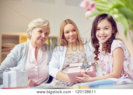 Cute girl congratulating her mother and grandmother with Motherâ??s Day