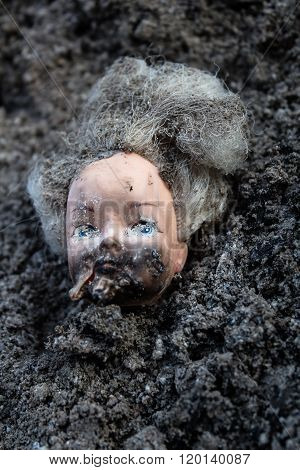 Scald Girl Doll Head Lie In A Pile Of Ash