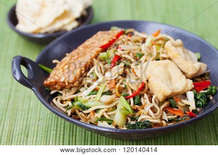 Mi goreng,mee goreng Indonesian cuisine, spicy stir fried noodles with and assortment of asian sauce