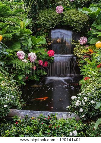Butchart Garden Park on Vancouver Island, Canada. Gorgeous three-stage fountain surrounded by flowers
