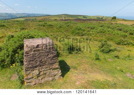 Trig Point on North Hill near Minehead UK with beautiful Somerset countryside in the west of England