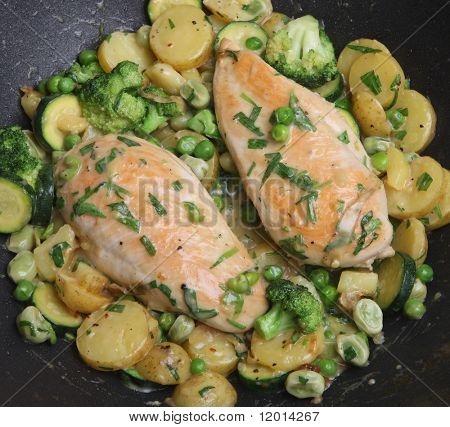 Tarragon chicken cooking in wok.