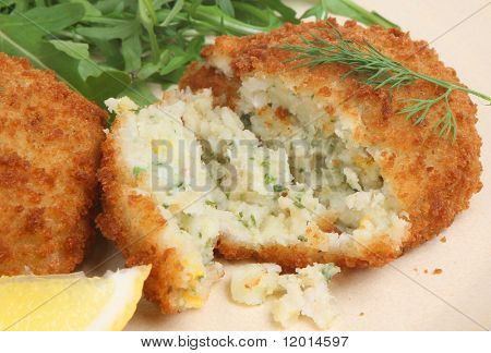Fishcake with haddock, mashed potato and herbs.