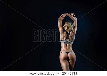 Beautiful  young fit woman   with slim muscular body
